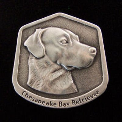 Chesapeake Bay Retriever Fine Pewter Dog Breed Ornament The sculpted image of your pet is surrounded with a wreath of holly and ivy. You will treasure this ornament for years to come. hey are made of Fine Pewter and come in a Christmas gift box for storing. Lindsay Claire is a Canadian manufacturer of Fine Pewter Gifts and Collectibles.  Each pewter item is cast in our shop from fine pewter and meticulously hand polished to a satin finish.Ornament is approximately 3  and has a satin cord attached for hanging.