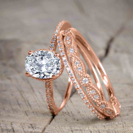 1.50 Carat Oval cut Moissanite and Diamond Trio Wedding Ring Set for Women in Rose Gold