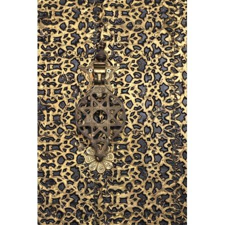 Ornate Brass Wall - Morocco. Detail of an ornate brass door and fancy door knocker. Print Wall Art By Brenda Tharp
