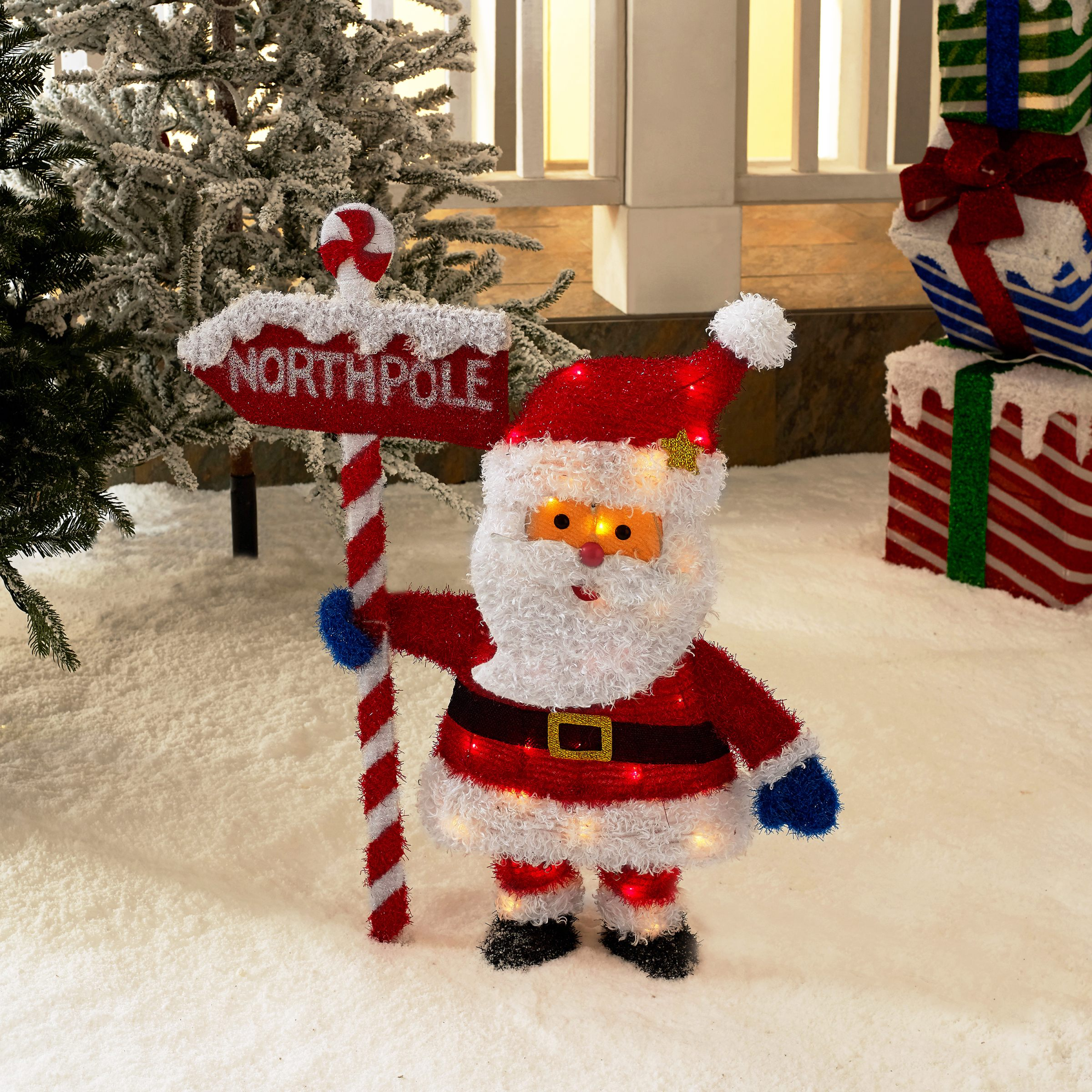 santa clause holding the northpole sign with lights outdoor christmas decoration