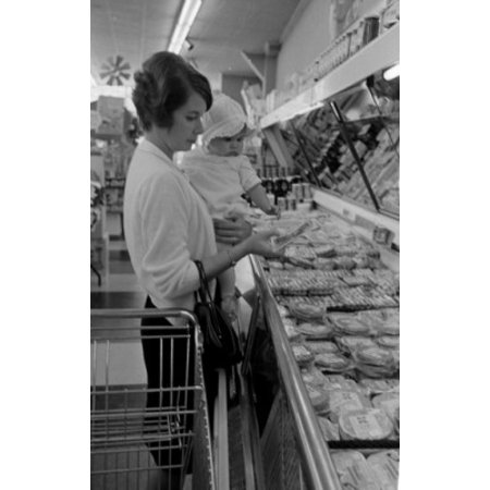 Woman with baby girl shopping in supermarket Canvas Art - (24 x 36)