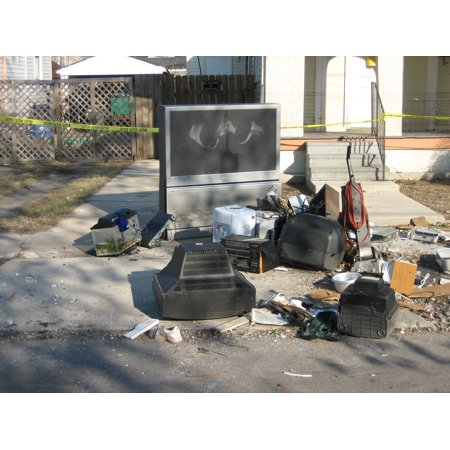 Canvas Print New Orleans after Hurricane Katrina: Appliances and possessions set on curb as trash in flood damage Stretched Canvas 10 x