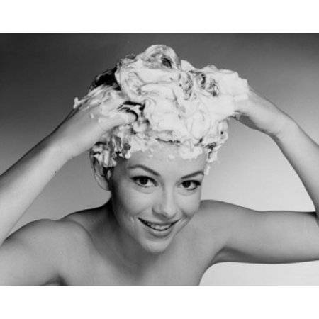 Portrait of a young woman shampooing her hair Canvas Art - (24 x 36)