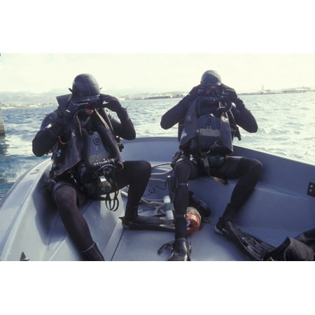 Navy SEALs combat swimmers in a utility boat adjust their dive masks Canvas Art - Michael WoodStocktrek Images (35 x 23)