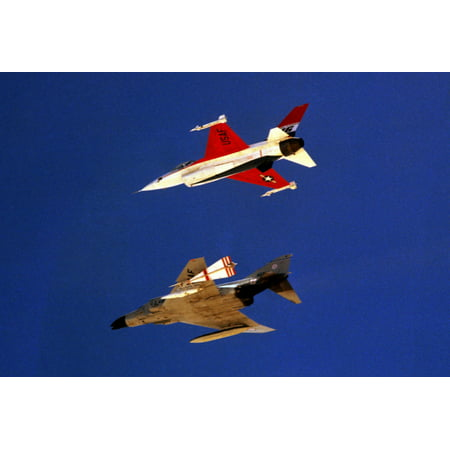 LAMINATED POSTER A U.S. Air Force McDonnell F-4C Phantom II aircraft flying in formation with a General Dynamics YF-1 Poster Print 24 x 36