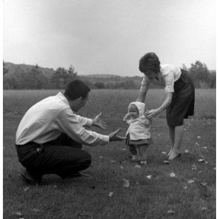Posterazzi Mother and father learning baby girl how to walk Canvas Art - (24 x 36)