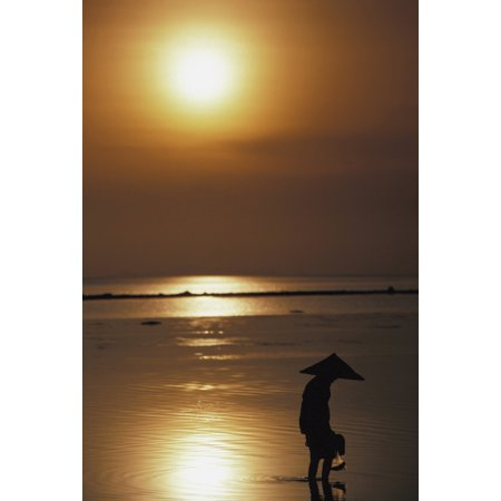 Woman In Conical Hat Collecting Shell Fish At Sunset - Conical Hat