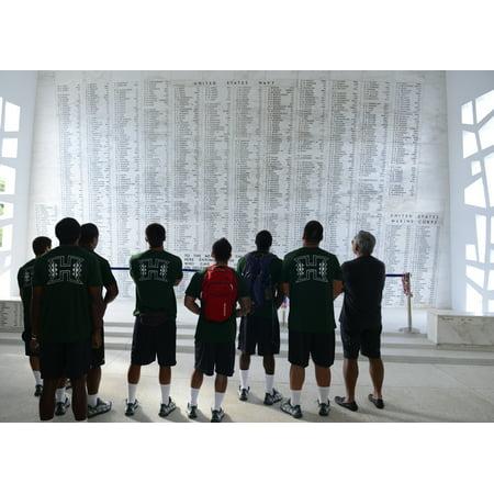 LAMINATED POSTER Members of the University Of Hawaii Rainbow Warrior football team visit the USS Arizona Memorial aft Poster Print 24 x 36