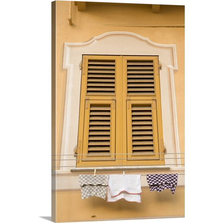 Great BIG Canvas | Wendy Kaveney Premium Thick-Wrap Canvas entitled Italy, Camogli. Yellow shuttered window and laundry on clothesline