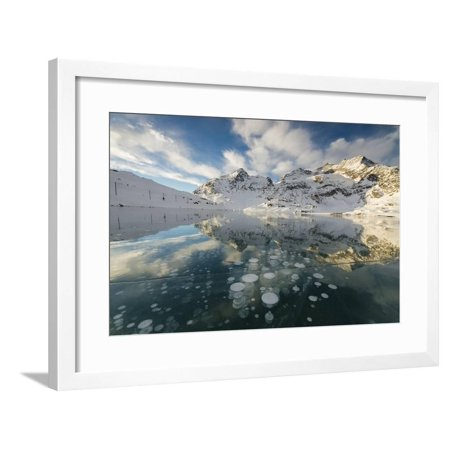Ice bubbles frame the snowy peaks reflected in Lago Bianco, Bernina Pass, canton of Graubunden, Eng Framed Print Wall Art By Roberto Moiola (Eng Framed)
