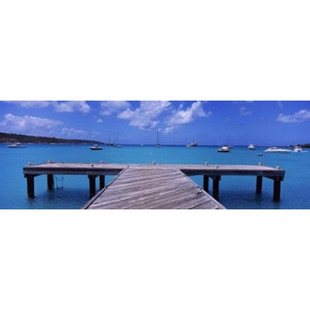Pier with boats in the background Sandy Ground Anguilla Canvas Art - Panoramic Images (18 x 7)