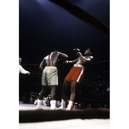 Muhammad Ali and Joe Frazier in the boxing ring Photo (Muhammad Ali And Joe Frazier Signed Boxing Gloves)