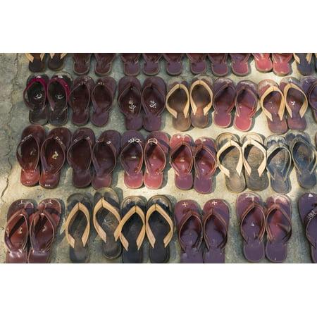 Myanmar. Mandalay. Maha Aung Myae Bone San Monastery. Lines of Shoes Print Wall Art By Inger Hogstrom