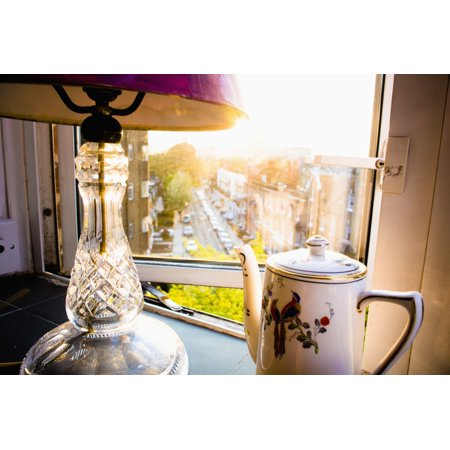 Teapot and lamp on windowsill in afternoon sun Barons Court West London England Canvas Art - Rick Senley  Design Pics (19 x 12) ()