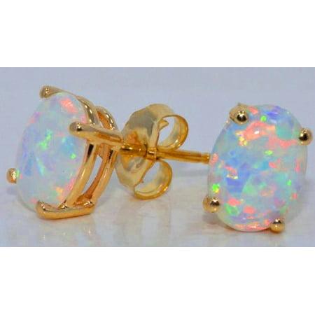 - 8x6mm Opal Oval Stud Earrings 14Kt Yellow Gold
