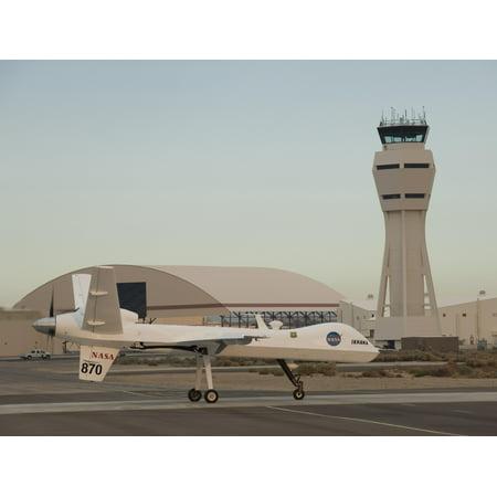 LAMINATED POSTER ED09-0242-42 NASA's remotely piloted Ikhana aircraft, a modified General Atomics Predator B, taxis t Poster Print 24 x 36