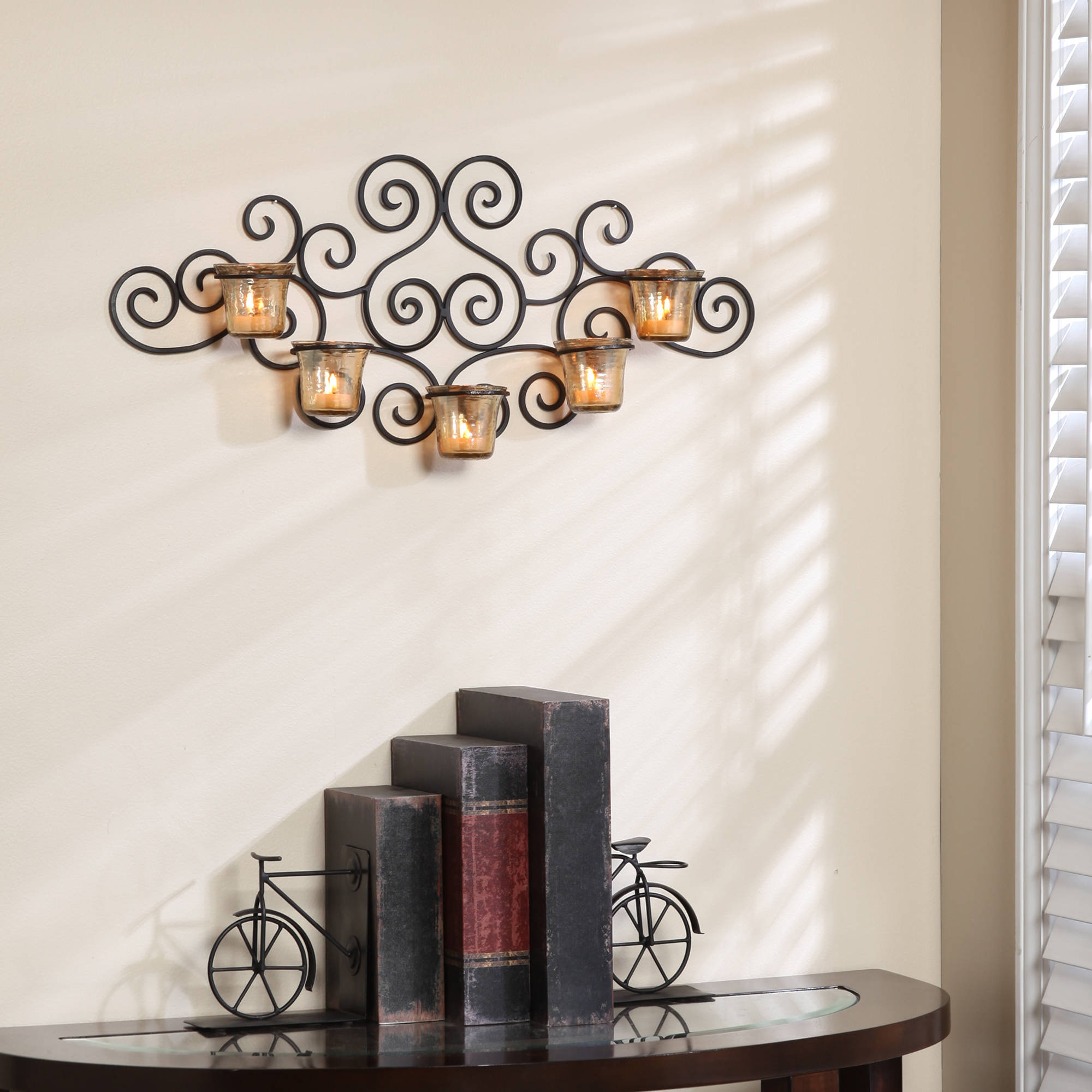 Click here to buy Better Homes and Gardens Ornate Scrollwork Candle Wall Sconce.