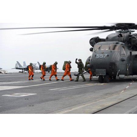 Atlantic Ocean January 28 2013 - Sailors board an MH-53E Sea Dragon aboard the aircraft carrier USS George HW Bush Poster Print