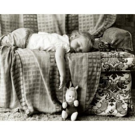 Side profile of a baby girl sleeping on a couch Canvas Art - (24 x 36)