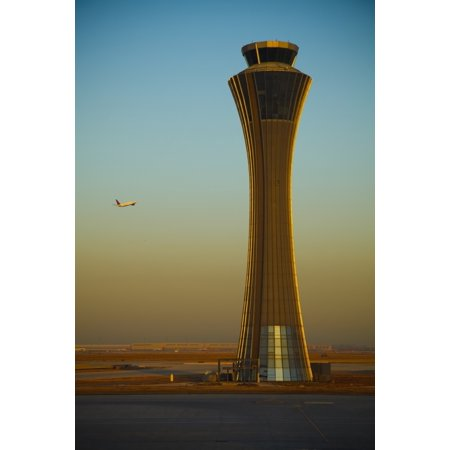 An Airplane Flies Past The Air Traffic Control Tower At The Beijing Airport Beijing China Canvas Art - Blake Kent Design Pics (24 x 38)