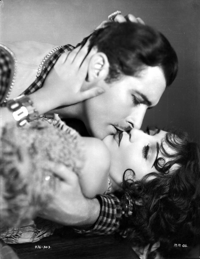 Bebe Daniels Kissing A Man While Holding His Head In Tube Dress Photo Print