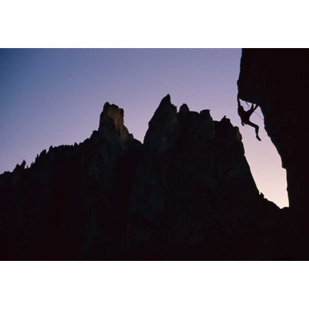 Smiths Clay (Climber silhouetted on Chain Reaction Smith Rocks Oregon Poster Print by Lionel Clay)