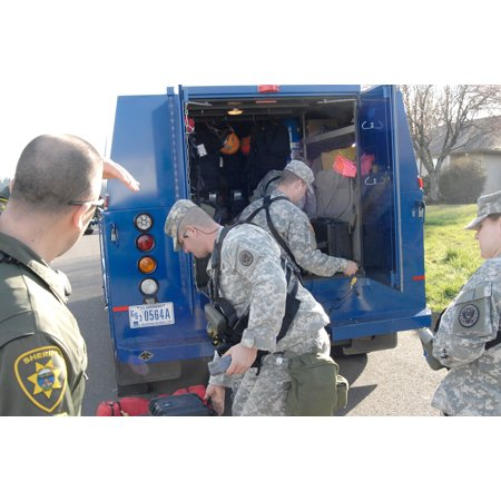 LAMINATED POSTER Members of the Oregon National Guard's 102 Civil Support Team deploy their equipment in a West Salem Poster Print 24 x 36 - Party Store Salem Oregon