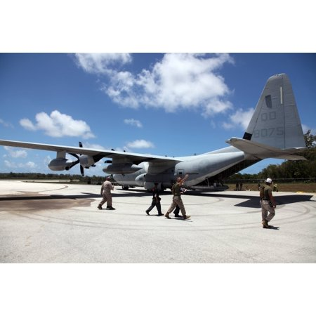 LAMINATED POSTER Marine Aircraft Group 12 Marine Wing Support Squadron 171 Marines unload dental supplies from a C-13 Poster Print 24 x 36