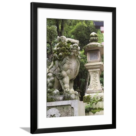A Guardian Stone Lion Traditional Stone Lantern at the Entrance to Kasuga-Taisha Shrine Framed Print Wall Art By Paul Dymond
