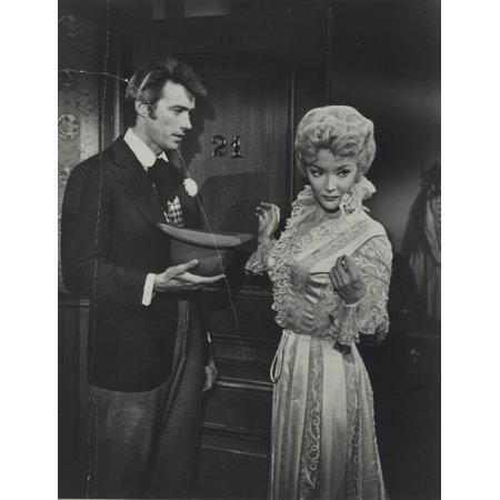 Clint Eastwood and an actress in period costume Photo Print