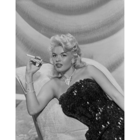 Pearl Cigarette (Jayne Mansfield sitting on the White Silk Couch in Black Sequin Strapless Dress and Pearl Necklace with Right Hand Holding a Cigarette Photo)