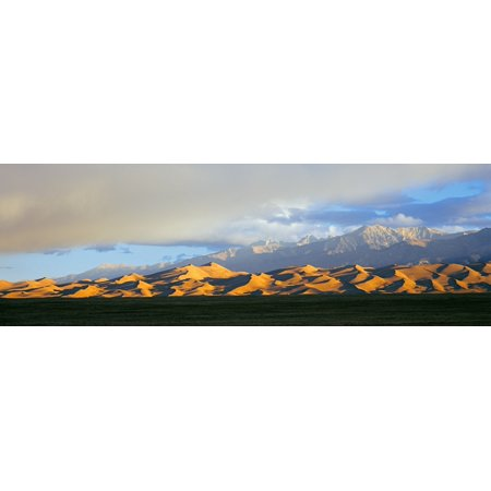 Sand dunes in a desert with a mountain range in the background Great Sand Dunes National Park Colorado USA Stretched Canvas - Panoramic Images (27 x 9) (Desert Mountain Park Halloween)