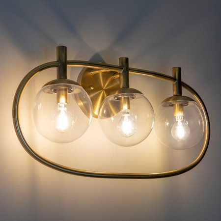 Griggs Globe Three Light Antique Brass Wall Sconce ()
