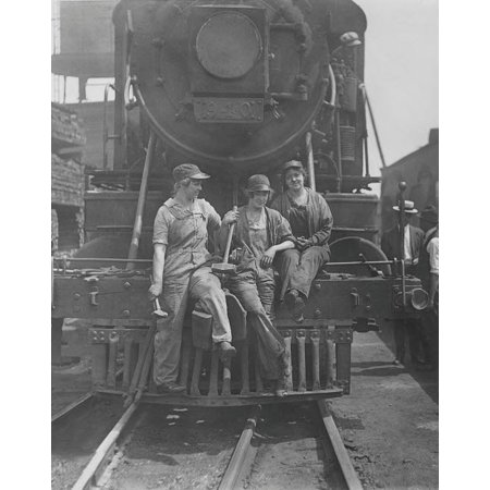 Women laborers seated on front of engine at Bush Terminal railroad yard 1918 Poster Print by Stocktrek Images