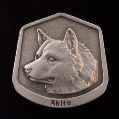 Akita Fine Pewter Dog Breed Ornament The sculpted image of your pet is surrounded with a wreath of holly and ivy. You will treasure this ornament for years to come. hey are made of Fine Pewter and come in a Christmas gift box for storing. Lindsay Claire is a Canadian manufacturer of Fine Pewter Gifts and Collectibles.  Each pewter item is cast in our shop from fine pewter and meticulously hand polished to a satin finish.Ornament is approximately 3  and has a satin cord attached for hanging.
