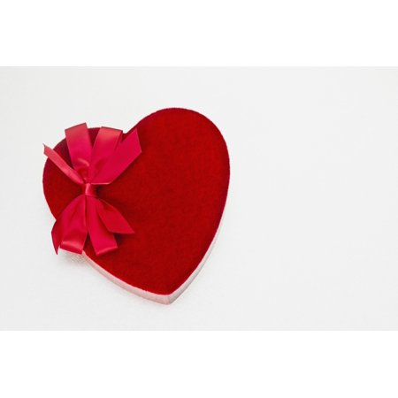 Valentines heart-shaped candy box against white background Stretched Canvas - Bill Brennan  Design Pics (38 x 24)