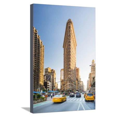 Cabs passing under the Flat iron building, New York, USA Stretched Canvas Print Wall Art By Jordan Banks 24' Under Cab 2 Light
