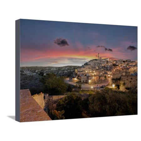 Sunset on the ancient town and historical center called Sassi, perched on rocks on top of hill, Mat Stretched Canvas Print Wall Art By Roberto Moiola - Compton Town Center