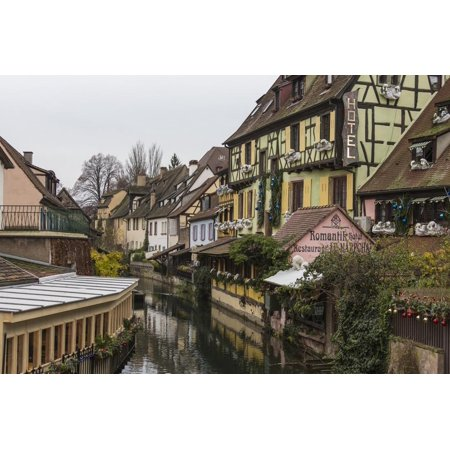 Colored houses reflected in river Lauch at Christmas time, Petite Venise, Colmar, Haut-Rhin departm Print Wall Art By Roberto Moiola