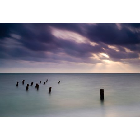 Wooden posts in sea under stormy sky at sunrise Placencia Stann Creek Belize Canvas Art - Panoramic Images (18 x 24)
