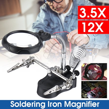 Helping Hands Soldering Iron Stand Magnifier Glass 3.5X&12X Lens Multi-functional Welding Magnifier LED Magnifying Glass with Soldering Iron Stand Adjustable Battery Clips Specification: 1. A useful Aid for soldering work or model makers. 2. Adjustable crocodile holding clamps. 3. Bottom battery compartment is furnished with steel plate which can enhance stability. 4. Ideal when a third hand is needed. 5. With two LED lighting,this model can work very well in the dark environment. 6. With three pcs of AAA batteries (not included),large capacity,this model can continuously discharge more than 10 hours,expediently be used. Product Specification: Material of lens: Glass Color: Black + Silver Product Overall Size: 170x140x160mm6.7*5.5*6.3inch Mail Lens Size: 60mm2.36inch Main lens magnifying multiple: 3.5X Accessorial lens magnifying multiple: 12X Package Included: