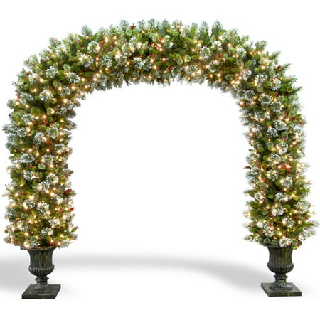 National Tree 8-1/2 Wintry Pine Archway with Cones, Red Berries and Snowflakes in Dark Bronze Fiberglass Pot with 900 Clear Lights, UL