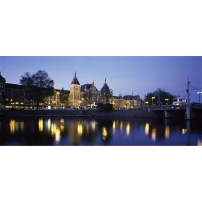 Reflection of a railway station in water  Amsterdam Central Station  Amsterdam  Netherlands Poster Print by  - 36 x 12 - image 1 of 1