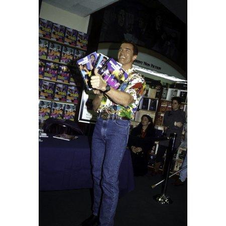 Arnold Schwarzenegger holding his book Photo