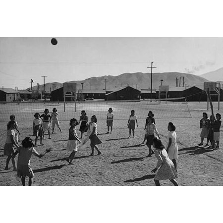women playing volleyball one-story buildings and mountains in the background  Ansel Easton Adams was an American photographer best known for his black-and-white photographs of the American West