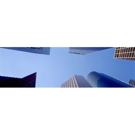- Low angle view of skyscrapers against blue sky Houston Texas USA Canvas Art - Panoramic Images (15 x 5)