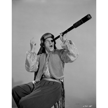 A Stanley Clements wearing an Arabian costume and using a telescope Photo Print