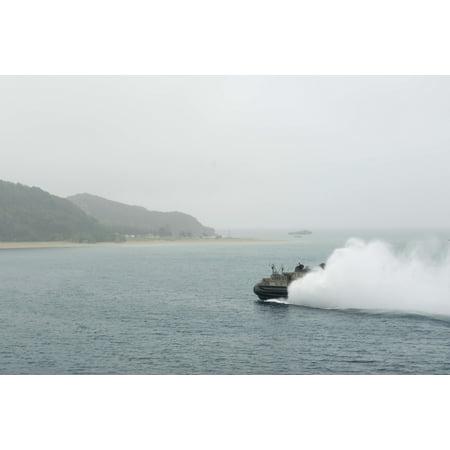 LAMINATED POSTER 150306-N-RU971-121 WHITE BEACH, Okinawa Landing Craft Air Cushion 21 propels through the water a Poster Print 24 x 36