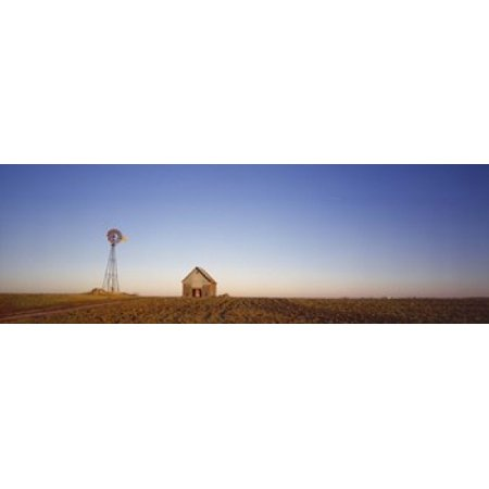 Windmill in a field near a farmhouse Illinois USA Canvas Art - Panoramic Images (18 x 6)
