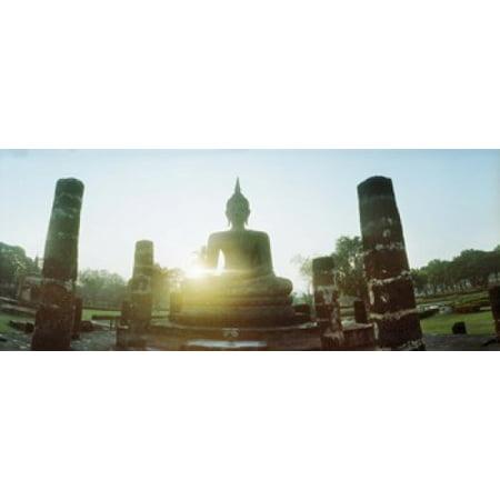 Statue of Buddha at sunset Sukhothai Historical Park Sukhothai Thailand Stretched Canvas - Panoramic Images (15 x 6)